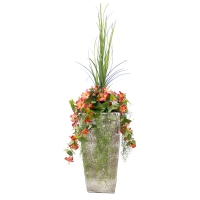 Outdoor orange hibiscus arrangement in beige planter