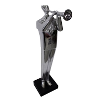 Silver statuette of a musician playing a trumpet 20''