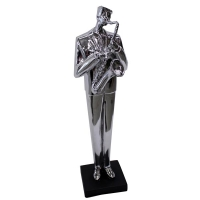 Silver statuette of a musician playing guitar 21''
