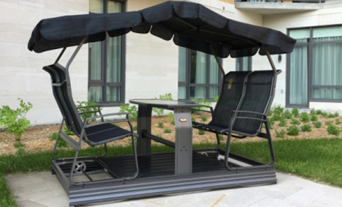 Oscillating chair and table in luxury outdoor environment