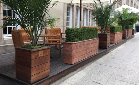 Luxury custom outdoor planters in front of hotel terrace
