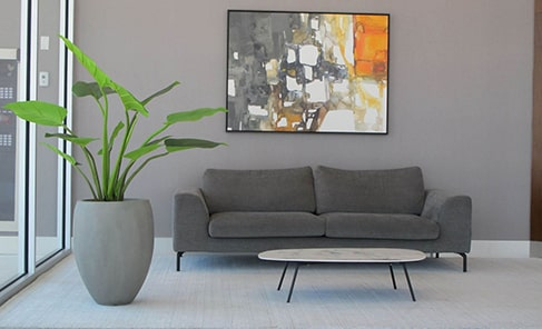 artificial plant in tall grey cement plant set in grey living with orange painting